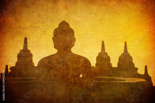 Vintage image of Buddha statue at Borobudur temple, Java, Indone