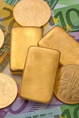 Geldanlage in echtem Gold als Goldbarren und Goldm