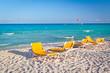 Empty deckchairs on the Caribbean beach