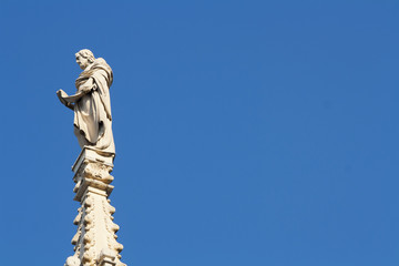 Ancient marble statue over the Milan cathedral