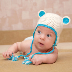 Charming newborn baby with blue eyes close-up.
