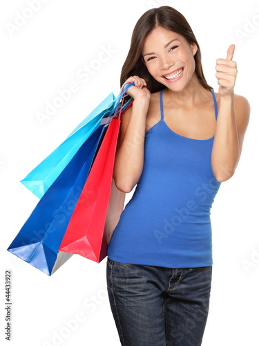Shopping woman thumbs up success