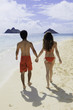 couple walking on a hawaii beach