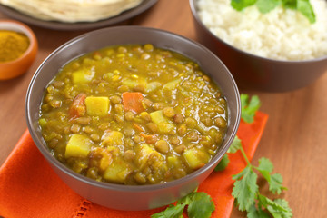Bowl of spicy Indian dal (lentil) curry with carrot and potato