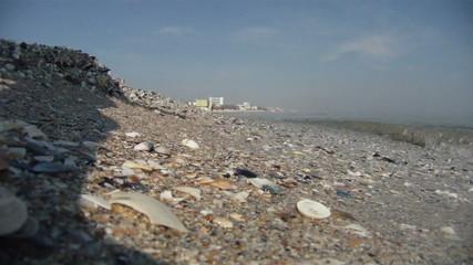 Rolling waves washing sea shore, underwater camera