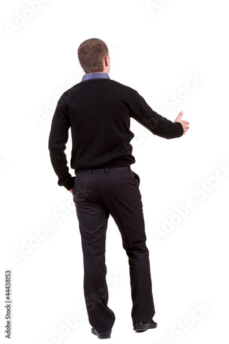 back view of businessman  reaches out to shake hands