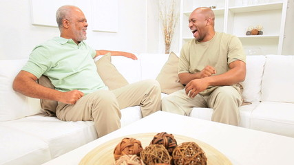 Elderly Ethnic Father Talking Son Home Sofa