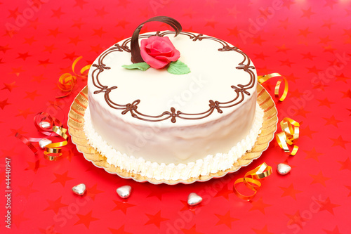 White cake on red background