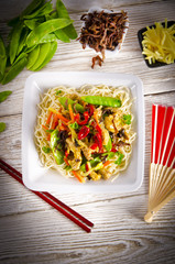 Noodles with pork and vegetables in plum sauce