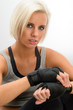 Kickbox woman put on protective gloves fitness