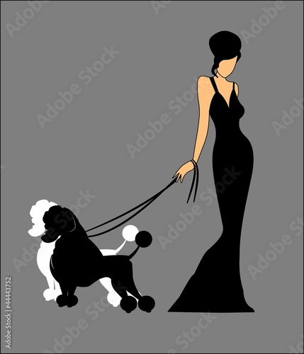 LADY HOLDING HER POODLES ON LEASH