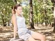 Girl in park enjoying music