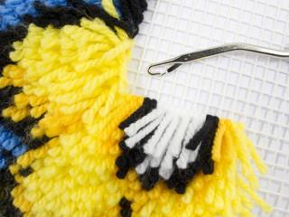 Latch Hook Rug stitch with canvas and yarn