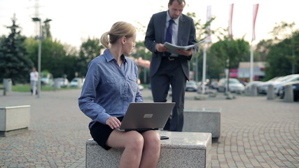 Business people with laptop and documents in the city