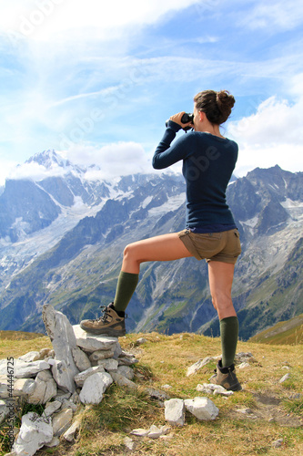 Young girl on mountain top with Mont Blanc panorama