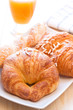 Brioches and orange juice for breakfast