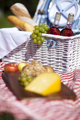 Picnic basket with fruit bread and wine