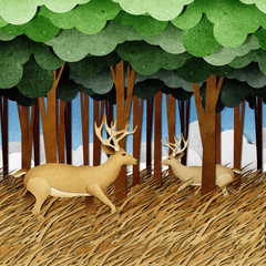 Deer made from recycled paper craft background