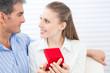 Couple Holding Box Ring
