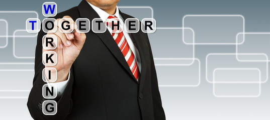 Businessman with wording Working Together