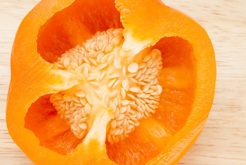 Close up image of half an orange pepper