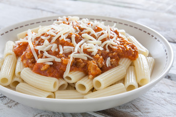 plate of macaroni with bolognese sauce