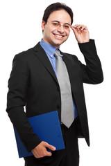 Smiling businessman holding documents