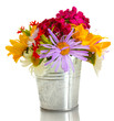 beautiful bouquet of bright wildflowers in bucket, isolated