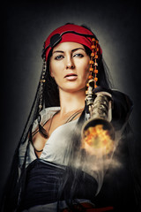 sexy female pirate shooting from gun