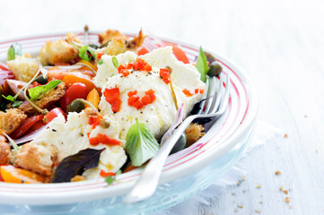 Fresh salad with tomatoes and cheese