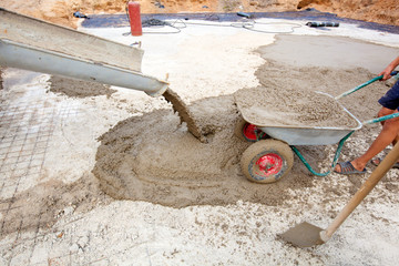 Concrete pouring works during foundation building
