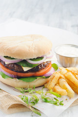 Burger and chips with mayo dip