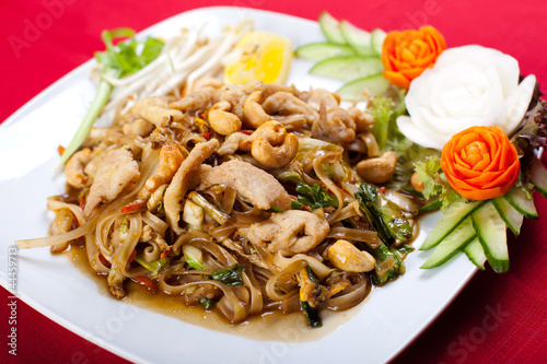 Thai style noodle stir fry with meat and cashew nut