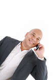 Business man talking on cell phone. Pleasant Look. One White. Bu poster