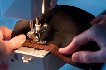 Seamstress Sewing On Velcro Hook-And-Loop Fastener