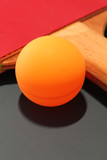 Close up of Table tennis racquet and ball