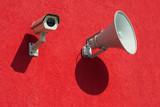 Surveillance camera and megaphone as symbols  propaganda poster