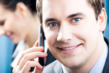 Businessman with cellphone at office