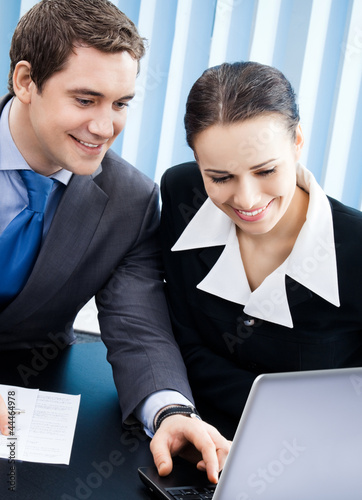 Businesspeople working with laptop at office