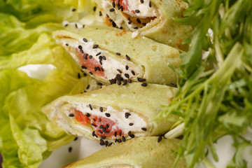 tasty appetizer with salmon and cheese