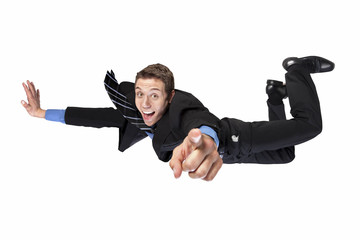 flying businessman pointing finger