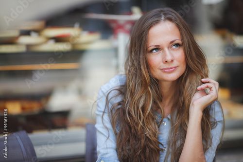 woman in street cafe