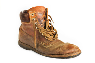Single brown leather work boot on white