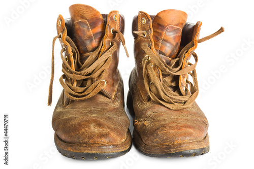 Pair of brown leather work boots on white