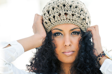Stock Photo: Portrait of a young black woman wearing a wool cap