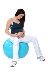 A pregnant woman exercising.