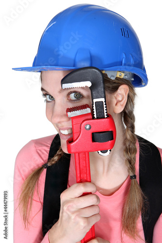 Funny female laborer with wrench