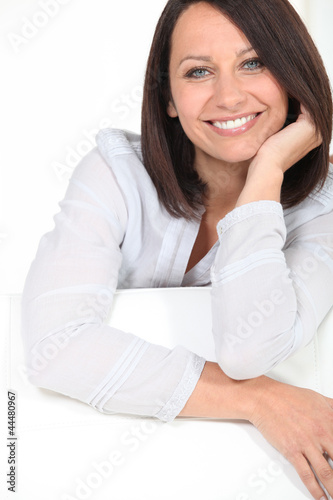 Woman chilling-out on sofa