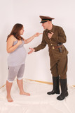 Pregnant woman and a man in uniform