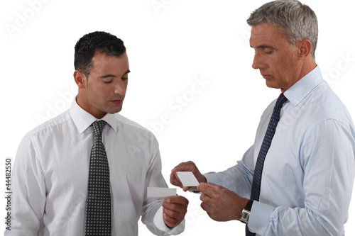 Executives exchanging business cards
